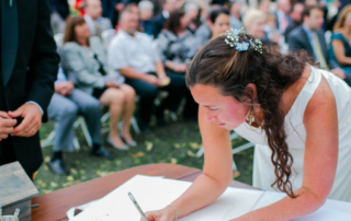Bride signing her Quaker Wedding Certificate