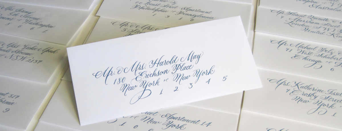 Skinny white wedding envelope with calligraphy addressing