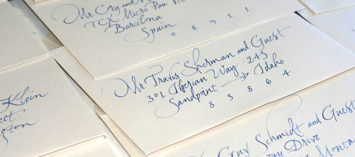 White wedding envelope with colored ink calligraphy addressing
