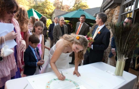 Image of a bride signing a Quaker Wedding Certificate