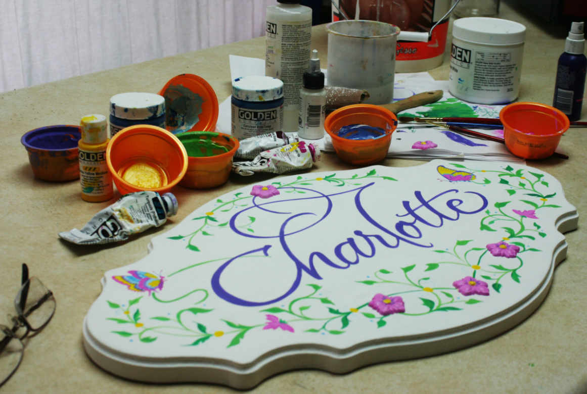 A baby name board with paints and work space