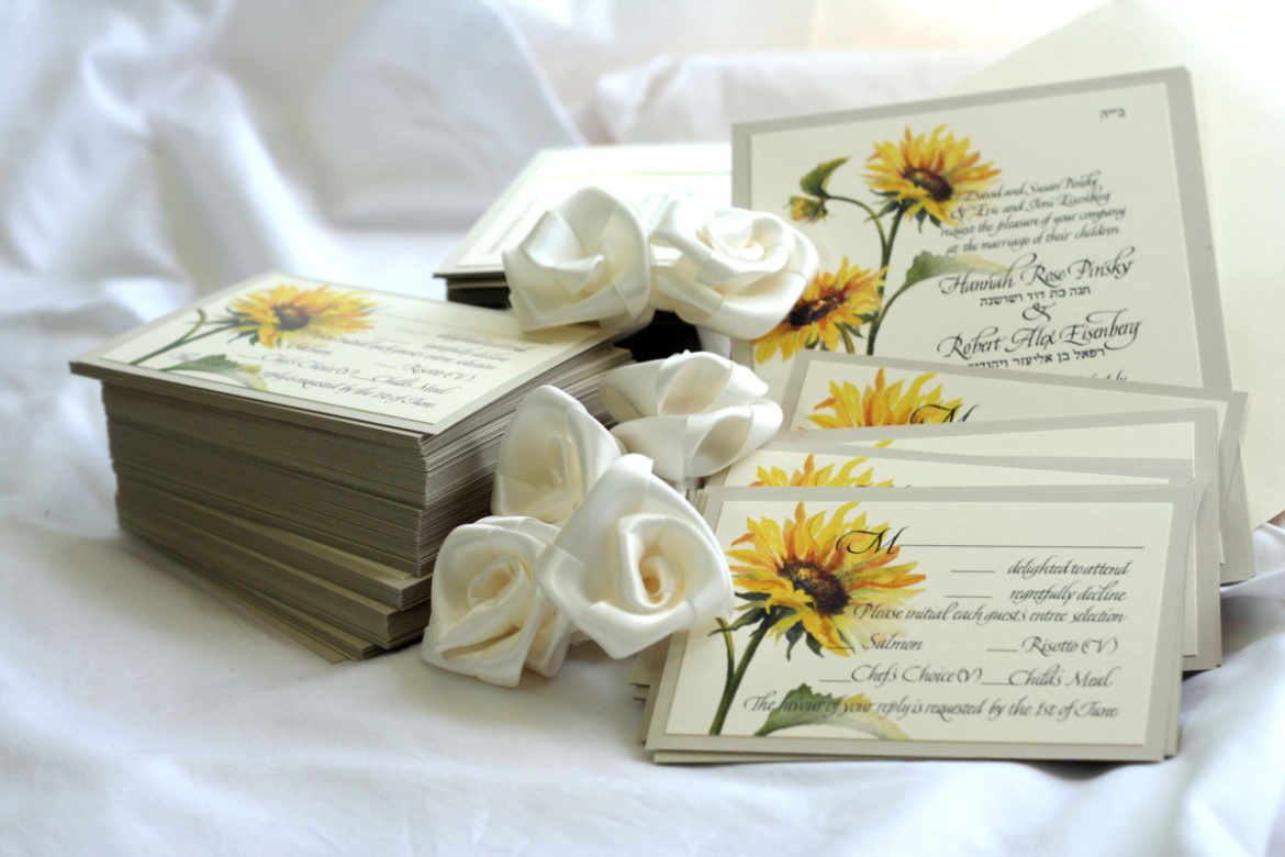 Sunflower wedding RSVP cards ready to send to guests